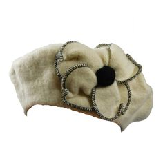 Adorable fashion beret. Large flower accent with stitched edges. One size fits most. Girl's 7-8 and up.+ Wool