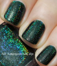 Glitter Gal Lizard Belly is a blackened teal green with holographic shimmer that creates a prismatic rainbow effect on the nail.