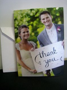 """Get a canvas sign that says """"thank you"""" similar to the other signs and hold it for a picture to be used for your thank you cards"""