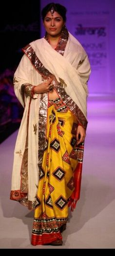 Yellow printed silk saree by Gaurang Shah - I love the traditional print