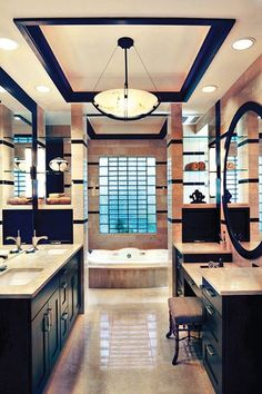 love the double sinks and the vanity to sit at on the other side...to prep for makeup, etc.