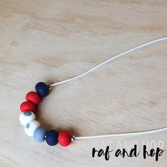Polymer clay bead necklace. Red navy white grey 'the by RafHop