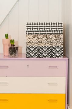 Decorative storage + dresser with different colored drawers