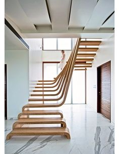 This cascading wood staircase, located in a Mumbai, India, apartment, was designed by the Mexican architecture firm Arquitectura en Movimiento Workshop.