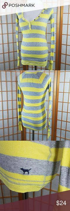"""Victoria's Secret PINK striped long sleeve shirt Victoria's Secret PINK striped long sleeve shirt yellow and gray, witj button details and unfinished hem at neckline. Size XS measures 13"""" across from armpit to armpit when laid flat and is  25"""" long from back neckline to hem. Excellent used condition. Tops Tees - Long Sleeve"""