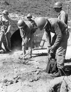 American troops planting demolition charge to destroy a small bridge somewhere in Korea. 25 Jul 1950