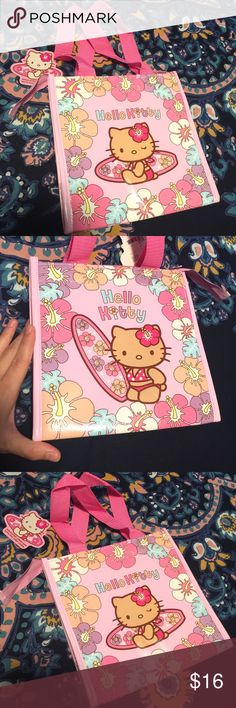 """Hello Kitty Lunch Bag Insulated Tropical exclusive NWT Hello kitty Hawaii insulated lunch bag. Cute tropical hibiscus flower design with hello kitty in a bikini  with a surfboard. Bright and cheery, perfect for hello kitty fans or kids.   Lunch bag body measures 8.75""""x 8.75""""x5.5"""" Bag strap drop measures approximately 7""""   Hawaii exclusive, no longer sold hard to find Hello Kitty Bags Totes"""