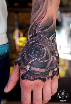 Black Ink Rose Tattoo On Left Hand