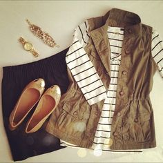 Army Green Vest. Thin Black Stripes on White 3/4 Sleeve Shirt. Black Skirt. Long Gold Necklace. Gold Watch.