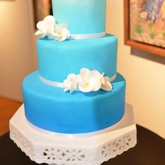 California Skies Wedding Cake - three tier airbrushed cake with white frangipani sugar flowers Wedding Cake - Cake or Death