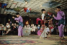 Malays in traditional dress dance for guests at the Raffles Hotel in Singapore, August 1966.  Photograph by Winfield Parks, National Geographic