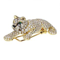 Cartier Gold Diamond Panther Brooch | From a unique collection of vintage brooches at https://www.1stdibs.com/jewelry/brooches/brooches/