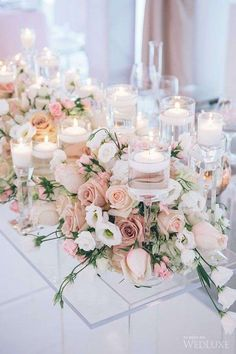 Wedding Decorations wedding centerpieces pink with spring flowers and roses and candles love theory - Wedding centerpieces are one of the key positions of the wedding decor. The most impressive, of course, are the floral wedding centerpieces. Pink Wedding Centerpieces, Wedding Flower Arrangements, Floral Arrangements, Wedding Bouquets, Centerpiece Ideas, Head Table Wedding Decorations, Blush Centerpiece, Flower Table Decorations, Wedding Centerpieces
