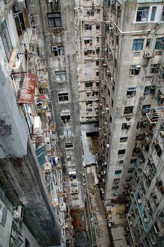 Vertical slums might not be the solution either. We need to find ways to create micro economies within slums that target infrastructural growth, and built sustainably by the inhabitants themselves. City Landscape, Urban Landscape, Urban Photography, Street Photography, Kowloon Walled City, Stephen Shore, Edward Hopper, Slums, Future City