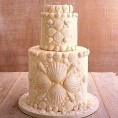 Seashell wedding cake by CakeGirls. See more options here- http://weddings.wikia.com/wiki/Summer_Wedding_Cakes