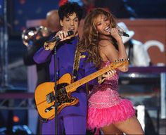His purple highness, Prince, performs with Beyoncé at the Grammy Awards.