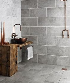 This bathroom wall tile shape would look old world in the right color. Def wrong grout color