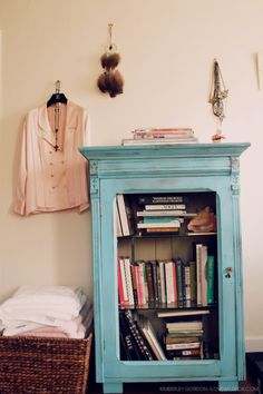 Gorgeous turquoise cabinet. Love it.