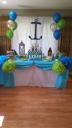 DIY baby shower, food table. Chevron gray fabric, turquoise plastic table cover, blue and lime green poms, balloons, DIY anchor, DIY cupcake stand and loads of other cuteness!