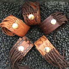 Leather cuffs that are handmade by Rowdy Ann out of up-cycled belts. These cuffs are all unique and once a style is gone it is gone. Better act fast these cuffs are hot items and sell quickly. $25!