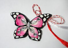 Polymer clay butterfly march charm   https://www.facebook.com/pages/Yippi/177229935734986