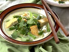 This flavorful Thai green curry is made with a seasoned coconut milk base, tofu, fresh veggies, and topped with fresh basil, cilantro and scallions.
