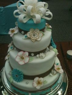 Fondant wedding cake. Tiffany blue, brown and white. Sugar paste flowers. 3, 6 inch layered cake.