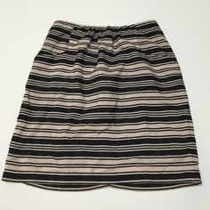 Emmelee Striped Skirt 100% Polyester. One small thing I noticed was on the back there is a white dot. It's tiny (like the tip of a ball point pen) and seems like the textile just didn't dye there. Other than that this is in great shape. Size small however, I'm a zero in skirts and I say this is more like a 0/2. Lightest pink-almost nude color and black. Emmelee Skirts