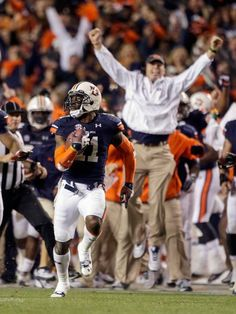 Auburn cornerback Chris Davis (11) returns a missed field goal attempt 100-plus yards to score the game-winning touchdown as time expired in the fourth quarter. Auburn won 34-28.  (Dave Martin/AP)