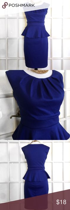 """Enfocus Studio Royal Blue Peplum Dress This beautifully designed and extremely flattering Peplum Dress is perfect for Holiday Parties or a stylish day at the office! Pleated scoop neck, fitted Peplum waist and size zip closure. 72% Polyester, 26% Rayon 2% Spandex Machine Wash/Line Dry. Bust 40"""" Waist 32"""" Length 37"""" Enfocus Studio Dresses Midi"""