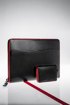 """""""Teste"""" versatile iPad holder Size: 28x21x3cm Black lining in smooth calfskin and hand boarded red goatskin PM15C0011-VRND FoREGRoUND """"Rostrales"""" compact zipped wallet Size: 3x11cm Model shown in printed black diamond full-grain calfskin Black lining in smooth calfskin and hand boarded red goatskin PM15C013-VRD Also available in black caviar full-grain goatskin, black full-grain bull-calfskin, black full-grain calfskin and smooth double-tanned calfskin www.anonyme-paris.fr"""