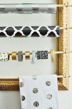 Make a gift wrap, ribbon and tissue paper organizing station using a large picture frame via monicawantsit.com