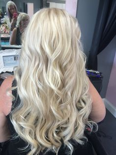 Beautiful long platinum blonde beach waves! So much texture and body! Hair by Pink the Beauty Boutique. 864-592-2554