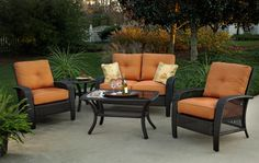 Martinique Deep Seating by Agio with Arlo Texture Rust/Olefin tropical floral pattern.