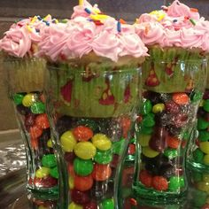 Idea from a pin. Cupcakes & candy in coca cola bottles. Girls decorated all of them.