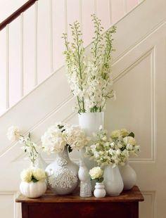 Foyer With White Flower Vases