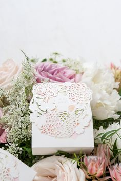 This Floral Garden Favor Box with original watercolour floral print peeks through delicate filigree to create the picture of garden beauty. Use this delightful little box to package a sweet treat or miniature trinket and you can be assured your favors will not be overlooked.