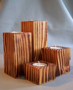 Hi, I crafted this set of four cedar tea light holders out of left over materials from our larger projects. I just couldnt throw it in the fire pit. They are about 2 3/8 square, the tallest one is 6 1/8. I wire wheeled, sanded, torched, and sealed them with an exterior satin urethane. There is repurposed Ultra Suede on the bottoms to protect your furniture. I love the texture and grain on this set. They feel good and look amazing. This set would make a great gift, part of a gift bas...
