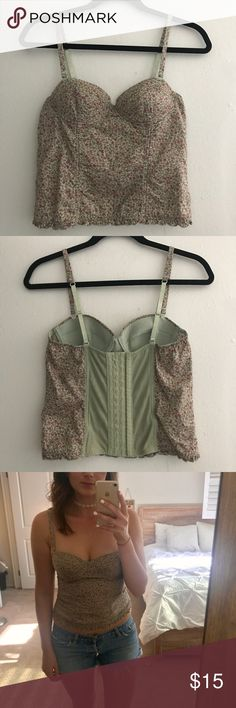 Bustier corset lingerie/top Delicate floral pattern. Straps can be removed. Worn once, great condition! Fits cup size 34C or smaller, but wouldn't suggest for larger bust. Size can be adjusted with the corset style hooks in the back. Bought it in lingerie section, but it's casual enough to wear as a top with denim! Forever 21 Tops Tank Tops