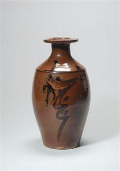 A vase with resist zig-zag design by David Leach