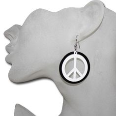 Wholesale peace sign earrings Black and White peace sign earrings are made of a lightweight metal. The center of the earring with the peace sign is unattached from the outer ring. This causes them to sway lightly back and forth. They are beautiful and yet simple. Truly a bargain at only $1.00 each pair.