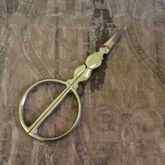 Items similar to Silver toned CIRCLE handle embroidery scissors roly poly style unique design on Etsy Small Scissors, Embroidery Scissors, Handle, Unique Jewelry, Handmade Gifts, Silver, Vintage, Etsy, Design