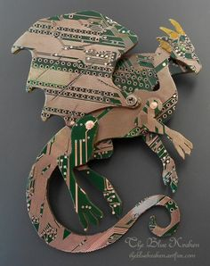 This dragon brooch is made from a dark green mother board. The board is cleaned of all elements then the copper traces polished brightly while still leaving the resin color on the surface and sealed i