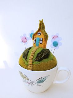 Not sure I can pull it off, but I am going to try!  Cute variation to the tea cup pin cushions.  Can't wait till January when things slow down and I can try new ideas.