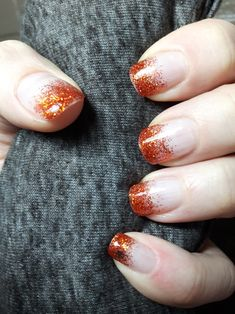 Fall nails. Orange and auburn sparkles cascading French tip. Spider on pinky for minimal Halloween effect