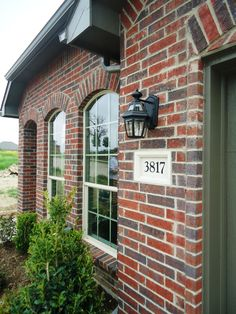 Village Homes: it's all in the details. Deep red brick with grey/green accents.