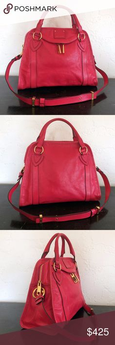 """Marc Jacobs Raspberry Pink Wellington Add some color to your wardrobe with this beauty that's no longer available in stores. It's about 14""""W x 11""""H x 6""""D with a 4"""" double handle drop and 12"""" strap drop. There is one small front zip pocket, and the top zip closure opens to a roomy interior with one zip pocket and one slip pocket. Very gently carried - the interior zip pull has slight wear from sliding, and there's minor wear on the protective metal feet. Marc Jacobs Bags Shoulder Bags"""