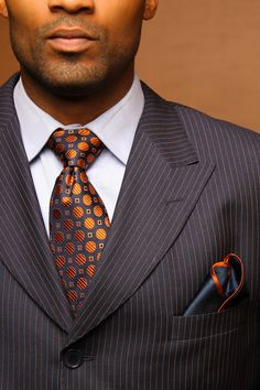 You know what they say about a man in a well tailored suit? Well...lol. Get him a great tie to go with it
