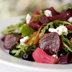 Recipe for Beet Salad With Goat Cheese and Walnuts Recipe - This scrumptious salad with a colorful display of dark-red beets on a mountain of mixed greens and fresh herbs is perfect. A sprinkling of fatty-acid-rich walnuts, which are thought to boost sex hormones, and crumbled goat cheese add tasty accents to the easy recipe.