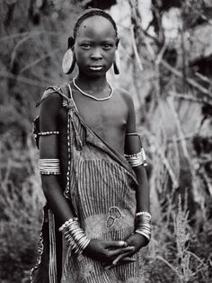 Omo River Valley tribes from Sebastião Salgado's forthcoming book Genesis. The metal bracelets on this Mursi girl's arm (some fashioned from shell casings) indicate high social status within the tribe, but in the larger world many Omo tribes lack direct representation in parliament and are powerless against development that threatens their way of life. In 1980, UNESCO declared the Lower Omo Valley a World Heritage Site in recognition of its uniqueness: